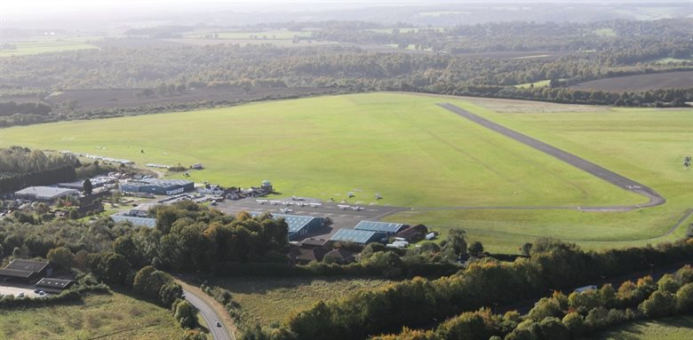 Long shot of Wycombe Air Park and surrounding roads and fields.